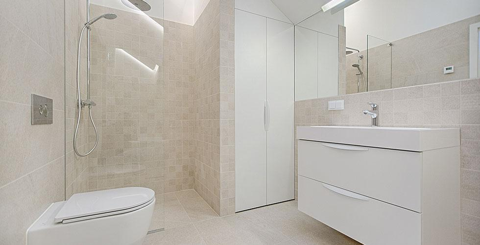 Gorgeous White Clean Bathroom with Glass Shower